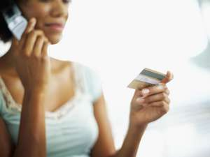 woman-giving-credit-card-over-the-phone.jpg